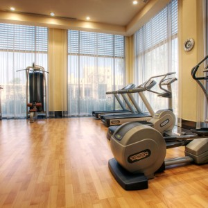 gym-room-luxury-resort-in-united-arab-emirates-with-white-window-curtains-plus-light-brown-laminate-flooring-tile